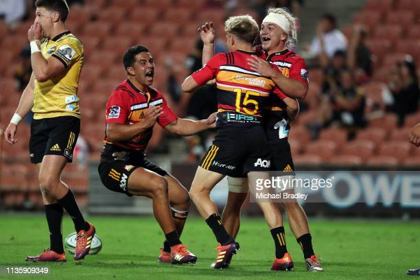 Chiefs Damian McKenzie celebrates with Anton LienertBrown his try with Mitchell Karpik during the round five Super Rugby match between the Chiefs and...