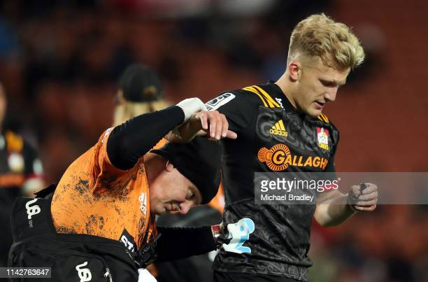 Chiefs Damian McKenzie is helped from the field during the round 9 Super Rugby match between the Chiefs and the Blues at FMG Stadium on April 13 2019...