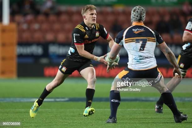 Chiefs Damian McKenzie looks to pass the ball during the round 18 Super Rugby match between the Chiefs and the Brumbies at FMG Stadium Waikato on...
