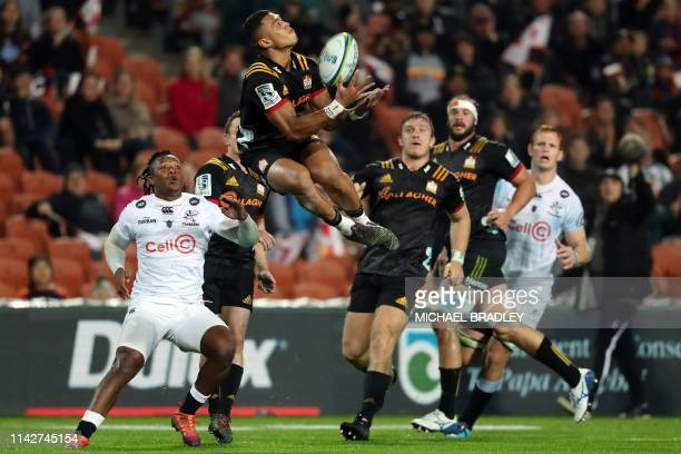 Chiefs' Etene NanaiSeturo catches the ball during the Super Rugby match between New Zealand's Waikato Chiefs and South Africa's Coastal Sharks in...