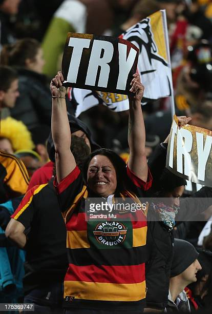 Chiefs fan celebrates a try during a Super Rugby Final match between the Chiefs and the Brumbies at Waikato Stadium on August 3 2013 in Hamilton New...