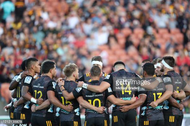 Chiefs have a moments silence during the round seven Super Rugby match between the Chiefs and the Hurricanes at Waikato Stadium on March 13, 2020 in...