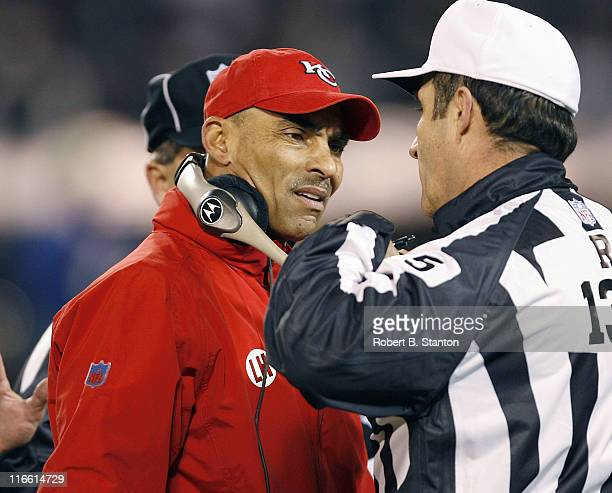 Chiefs head coach Herm Edwards with an official in the second half as the Kansas City Chiefs defeated the Oakland Raiders by a score of 20 to 9 at...
