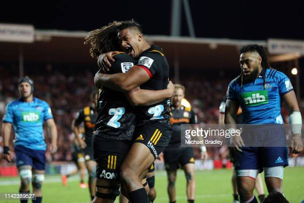 Chiefs Jesse Parete celebrates his try with Ataata Moeakiola during the round 9 Super Rugby match between the Chiefs and the Blues at FMG Stadium on...