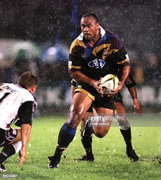 Chiefs Jonah Lomu steps inside Sharks Shaun Payne in the Super 12 match at Rugby Park Hamilton Friday The Chiefs won 3219