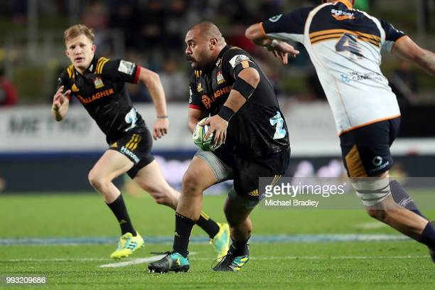 Chiefs Karl TuÕinukuafe looks to pass the Damian McKenzie during the round 18 Super Rugby match between the Chiefs and the Brumbies at FMG Stadium...