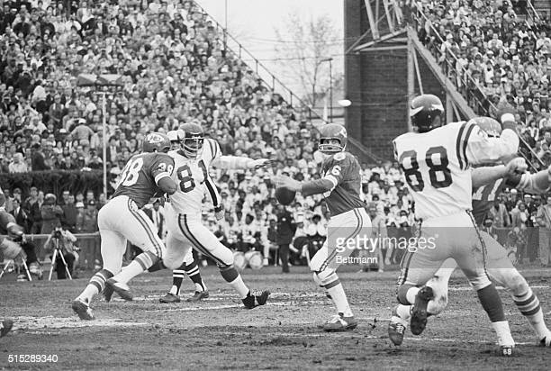 Chiefs Len Dawson getting ready to throw the ball as his teammates hold off Vikings Alan Paige and Carl Ellen at Super Bowl IV The Kansas City Chiefs...
