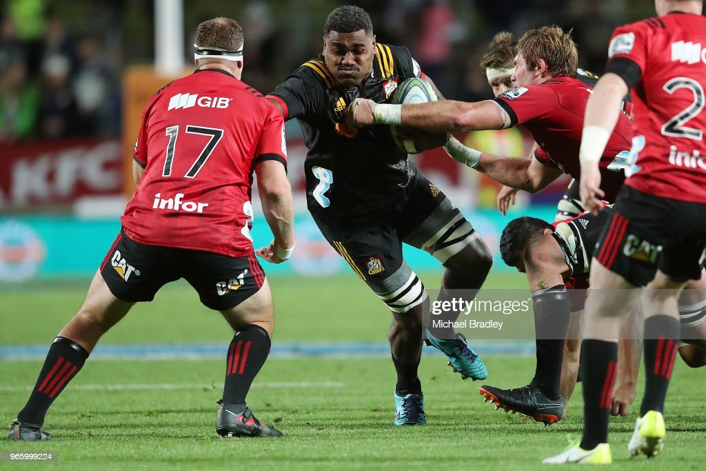 Chiefs Pita Gus Sowakula (C) looks to fend off the tackle during the round 16 Super Rugby match between the Chiefs and the Crusaders at Waikato Stadium on June 2, 2018 in Hamilton, New Zealand.