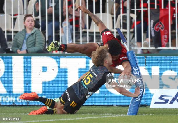 Chiefs player Damian McKenzie can't stop Crusaders wing Leicester Fainga'anuku from scoring a try during the round three Super Rugby Aotearoa match...
