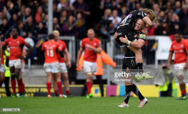 Chiefs player Jack Yeandle and Michele Campagnaro celebrate the last minute winning try during the Aviva Premiership match between Exeter Chiefs and...
