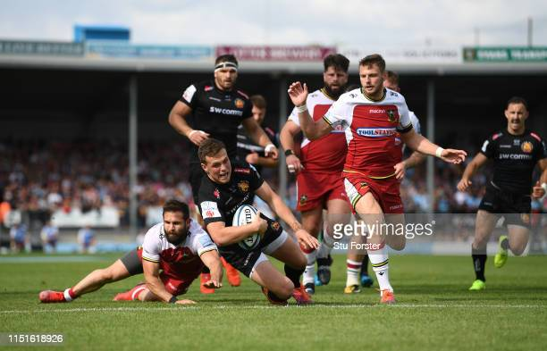 Chiefs player Joe Simmonds escapes from Cobus Reinach to score the second Chiefs try during the Gallagher Premiership Rugby Semi Final match between...
