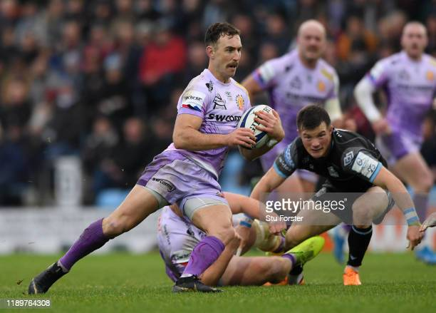 Chiefs player Nic White makes a break during the Heineken Champions Cup Round 2 match between Exeter Chiefs and Glasgow Warriors at Sandy Park on...