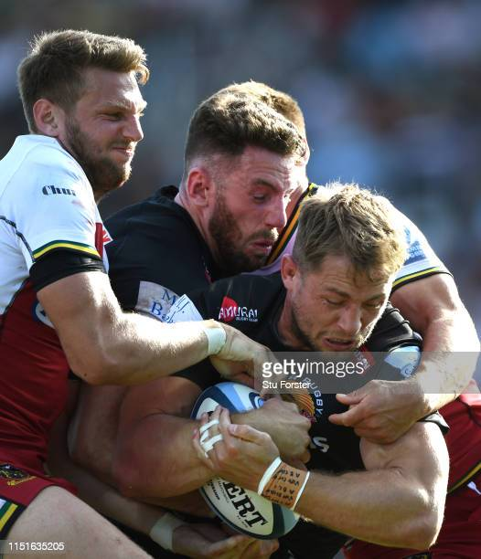 Chiefs player Sam Hill goes over for the final Chiefs try despite the attentions of Dan Biggar and Alex Cuthbert during the Gallagher Premiership...