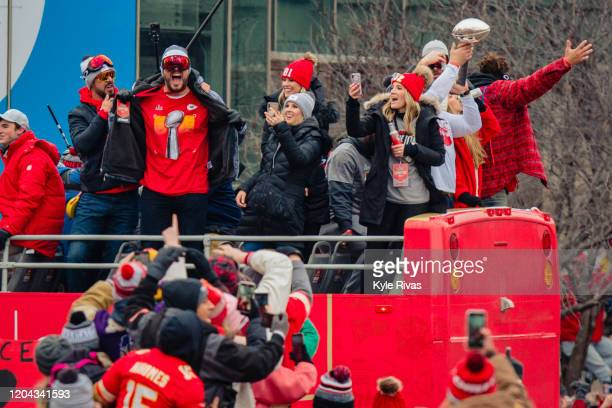 Chiefs players celebrate with fans during the Kansas City Chiefs Victory Parade on February 5 2020 in Kansas City Missouri