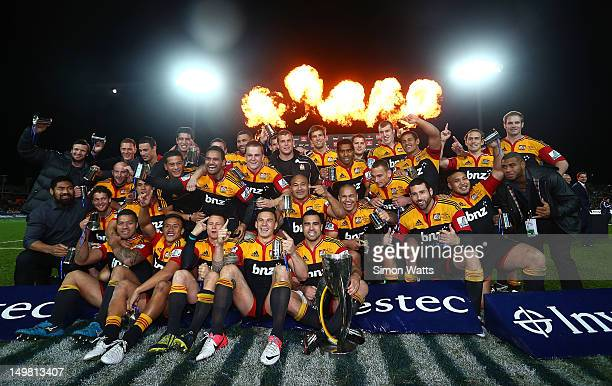 Chiefs players celebrate with the Super Rugby Cup after defeating the Sharks during the Super Rugby Final between the Chiefs and the Sharks at...