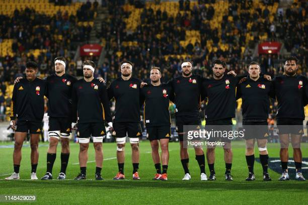 Chiefs players stand for an ANZAC commemoration during the round 11 Super Rugby match between the Hurricanes and Chiefs at Westpac Stadium on April...