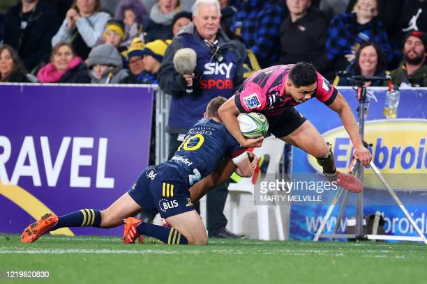 Chiefs' Quinn Tupaea is tackled by Highlanders' Mitch Hunt during the Super Rugby match between the Otago Highlanders and Waikato Chiefs at Forsyth...