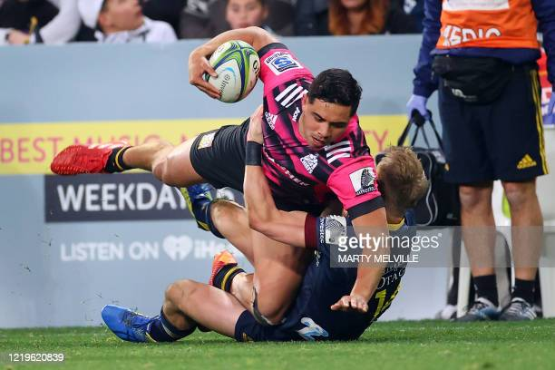Chiefs' Quinn Tupaea is tackled by Highlanders' Sam Gilbert during the Super Rugby match between the Otago Highlanders and Waikato Chiefs at Forsyth...