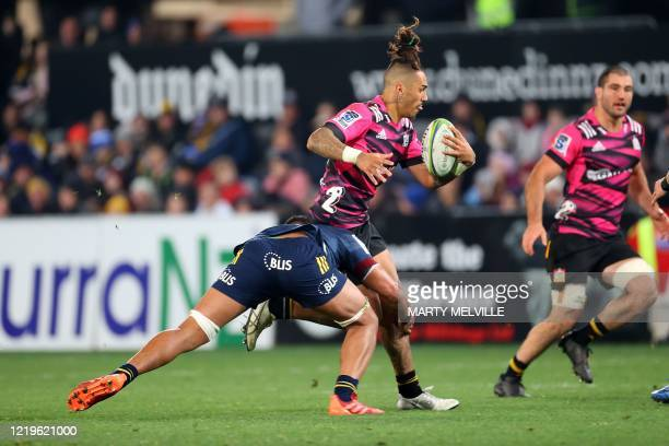 Chiefs' Sean Wainui is tackled by Highlanders' Shannon Frizell during the Super Rugby match between the Otago Highlanders and Waikato Chiefs at...