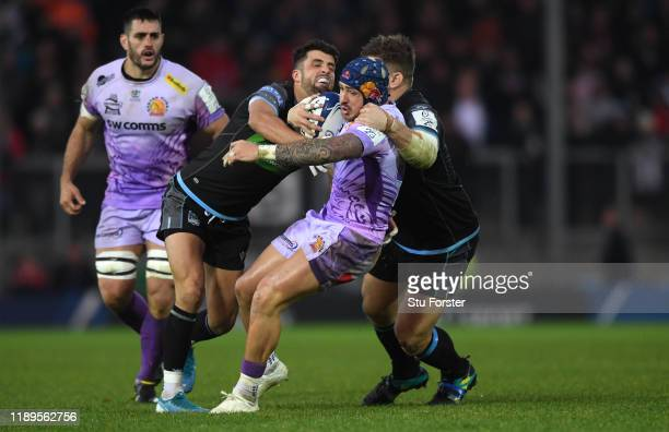 Chiefs wing Jack Nowell escapes the clutches of Adam Hastings during the Heineken Champions Cup Round 2 match between Exeter Chiefs and Glasgow...
