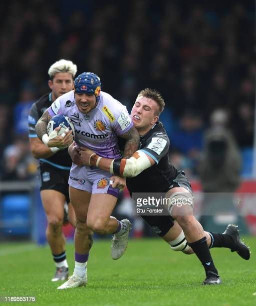 Chiefs wing Jack Nowell escapes the clutches of Matt Fagerson the Heineken Champions Cup Round 2 match between Exeter Chiefs and Glasgow Warriors at...