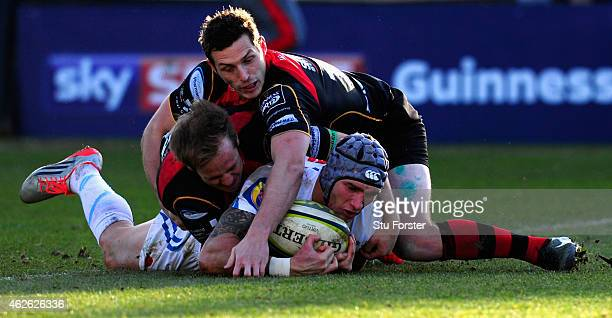 Chiefs wing Tom James bursts through to score during the LV= Cup group match between Newport Gwent Dragons and Exeter Chiefs on February 1, 2015 in...