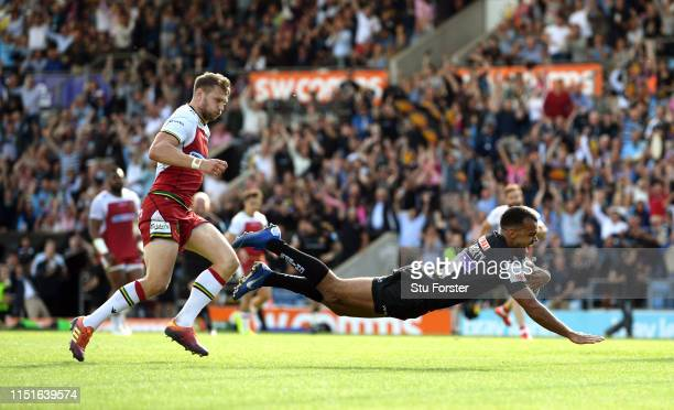 Chiefs wing Tom O' Flaherty dives over to score the 4th Chiefs try as Dan Biggar looks on during the Gallagher Premiership Rugby Semi Final match...