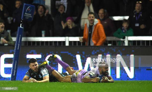 Chiefs wing Tom O' Flaherty dives over to score the fourth try despite the attentions of Ali Price of Glasgow during the Heineken Champions Cup Round...