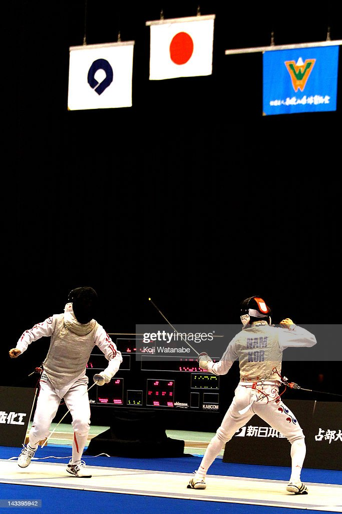Chieko Sugawara of Japan competes against Nam Hyun Hee of South Korea in the Women's Foil Team Tableau of final on day four of the 2012 Asian Fencing Championships at Wakayama Big Wave on April 25, 2012 in Wakayama, Japan.