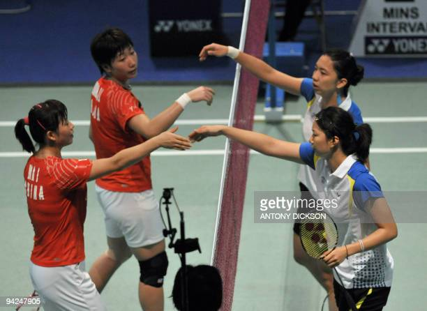 Chien Yu Chin and Cheng Wen Hsing of Taiwan shake hands after defeating Wang Xiaoli and Ma Jin of China in the women's team badminton final at the...