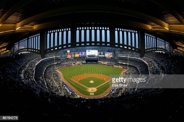 ChienMeng Wang of the New York Yankees throws the first pitch of the game to Aaron Miles of the Chicago Cubs during their game at Yankee Stadium on...
