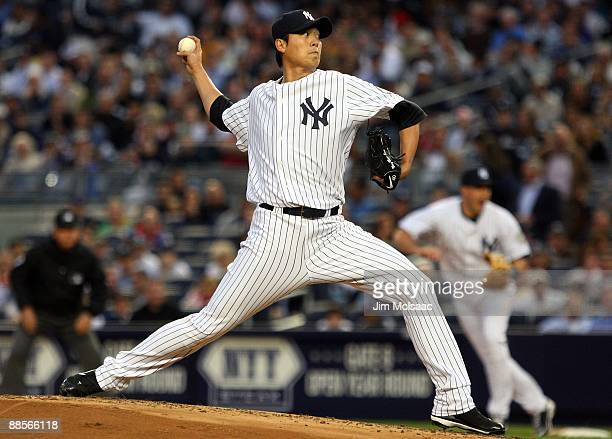 ChienMing Wang of the New York Yankees pitches against the Washington Nationals on June 17 2009 at Yankee Stadium in the Bronx borough of New York...