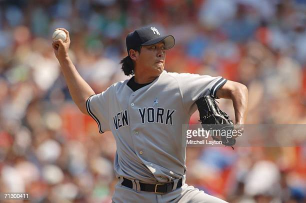 ChienMing Wang of the New York Yankees pitches during a baseball game against the Washington Nationals on June 18 2006 at RFK Stadium in Washington...