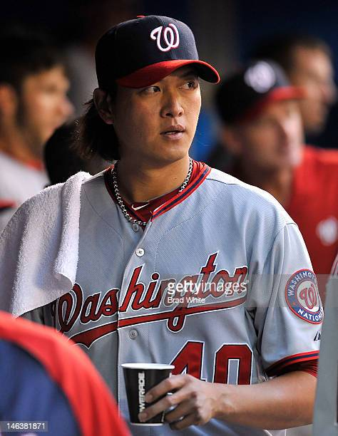 ChienMing Wang of the Washington Nationals looks on from the dugout during interleague MLB game action against the Toronto Blue Jays June 12 2012 at...