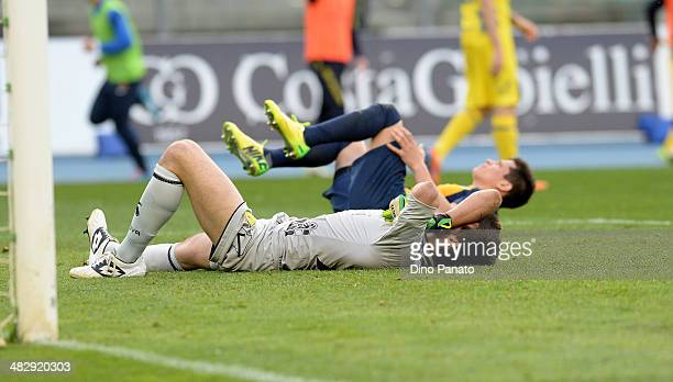 Chievo goalkeeper Michael Agazzi and Iturbe Juam Manuel Arevalos of Hellas Verona lies injured on the pitch during the Serie A match between AC...