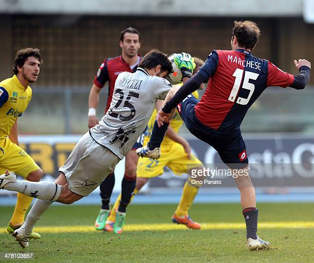 Chievo goalkeeper Michael Agazzi makes a save at the feet of Giovanni Marchese of Genoa CFC during the Serie A match between AC Chievo Verona and...