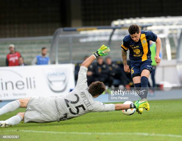 Chievo goalkeeper Michael Agazzi makes a save at the feet of Iturbe Juam Manuel Arevalos of Hellas Verona during the Serie A match between AC Chievo...