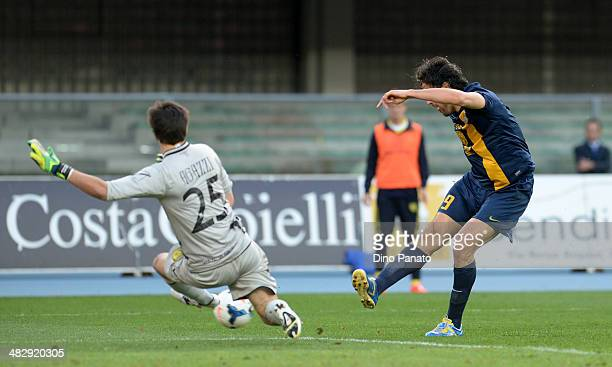 Chievo goalkeeper Michael Agazzi saves a shot from of Luca Toni of Hellas Verona during the Serie A match between AC Chievo Verona and Hellas Verona...