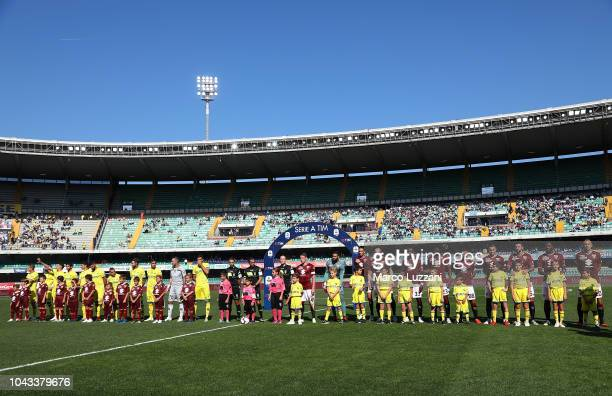 Chievo Verona and Torino FC teams line up before during the Serie A match between Chievo Verona and Torino FC at Stadio Marc'Antonio Bentegodi on...