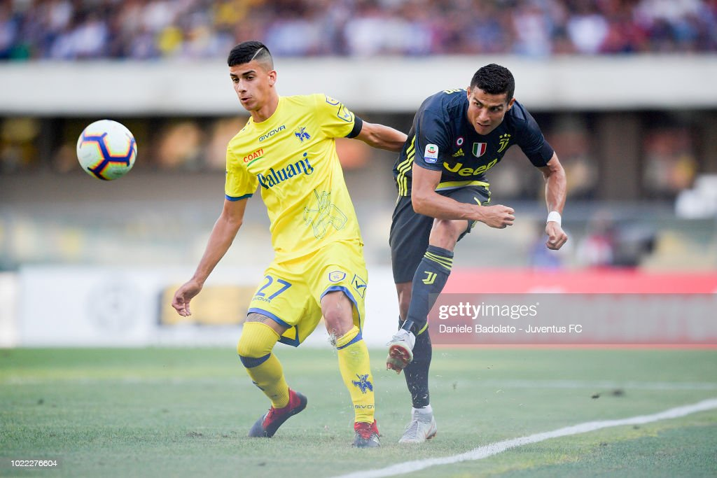 Chievo Verona Fabio Depaoli and Juventus player Cristiano Ronaldo in action during the serie A match between Chievo Verona and Juventus at Stadio Marc'Antonio Bentegodi on August 18, 2018 in Verona, Italy.