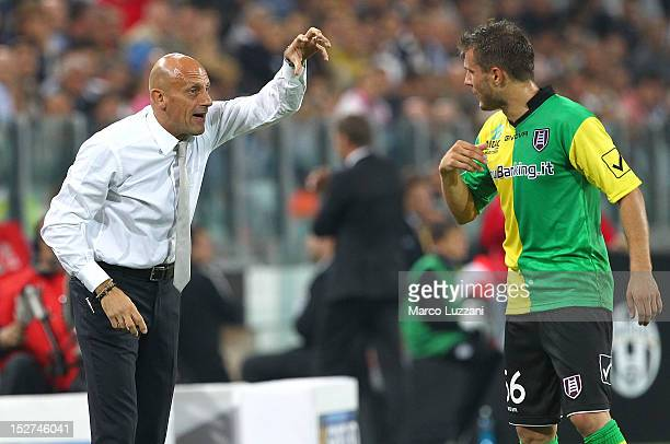 Chievo Verona manager Domenico Di Carlo issues instructions to his player Perparim Hetemaj during the Serie A match between FC Juventus v AC Chievo...