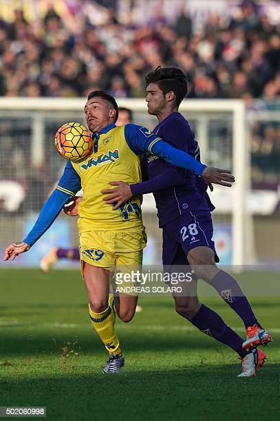 Chievo's defender from Italy Fabrizio Cacciatore fights for the ball with Fiorentina's defender from Spain Marcos Alonso Mendoza during the Italian...