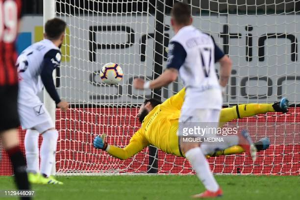 Chievo's Finnish midfielder Perparim Hetemaj scores a header past AC Milan's Italian goalkeeper Gianluigi Donnarumma during the Italian Serie A...