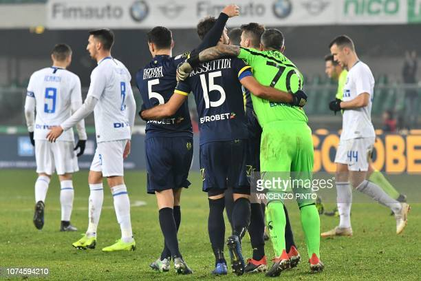 Chievo's Italian defender Luca Rossettini and teammates celebrates at the end of the Italian Serie A Football match Chievo Verona vs Inter Milan at...