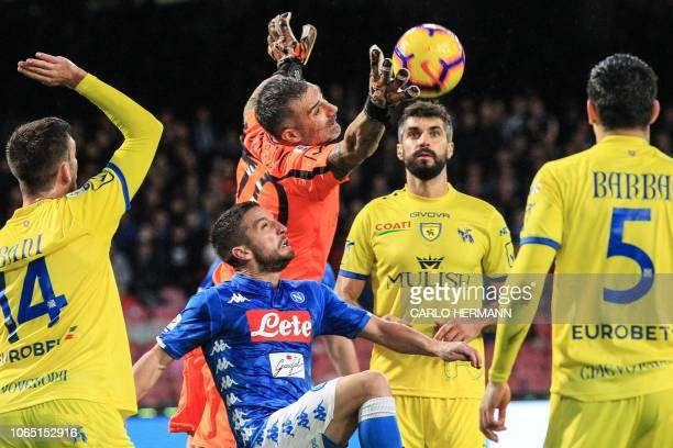 TOPSHOT Chievo's Italian goalkeeper Stefano Sorrentino deflects a shot under pressure from Napoli's Belgian forward Dries Mertens during the Italian...