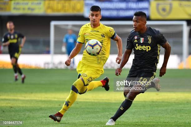Chievo's Italian midfielder Fabio Depaoli and Juventus' Brazilian defender Sandro go for the ball during the Italian Serie A football match AC Chievo...