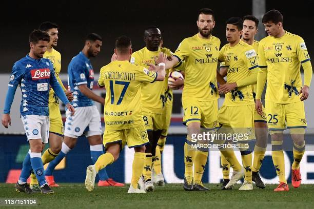 Chievo's Slovenian defender Bostjan Cesar celebrates with teammates after scoring during the Italian Serie A football match Chievo Verona vs Napoli...