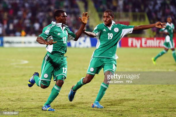 Chigozi Obasi of Nigeria celebrates his team's fifth goal with team mate Zaharaddeen Bello during the FIFA U17 World Cup UAE 2013 Group F match...