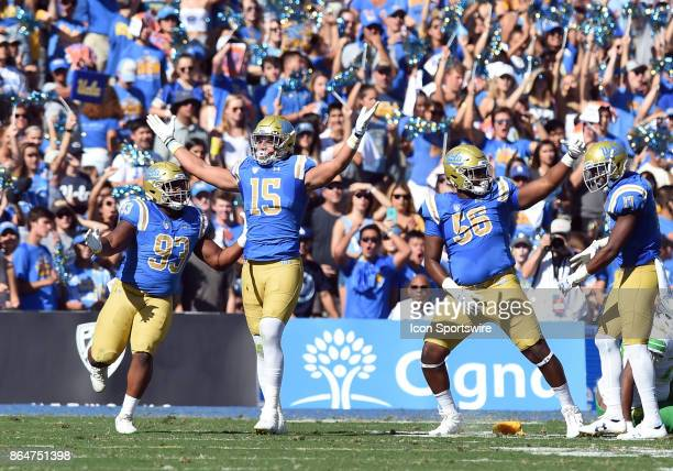 Chigozie Nnoruka UCLA Jaelan Phillips and UCLA Greg Rogers celebrate after stopping a run near the goal line during a college football game between...