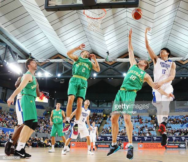 Chih Wei Lin shoots over Jesse Wagstaff of the Boomers during the FIBA World Cup Qualifying match between the Australian Boomers and Chinese Taipei...